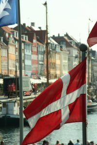 Flag of Denmark in front of Nyhavn, Copenhagen, Denmark Photo by: Niels Bosboom CC BY-SA 3.0